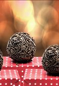 Traditional Brazilian Brigadeiro on a bokeh background