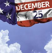 USA December 25, comemorative flag on a beautiful day