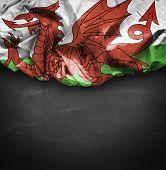 Wales waving flag on blackboard