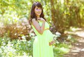 Beautiful Pregnant Woman Posing Outdoors