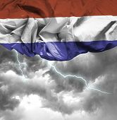 Netherlands waving flag on a bad day