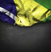 Brazil waving flag on blackboard