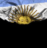 Argentina waving flag on black background
