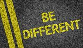 Be Different written on the road