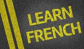 Learn French written on the road