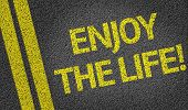 Enjoy the Life written on the road