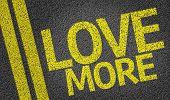 Love More written on the road