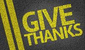Give Thanks written on the road