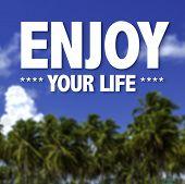 Enjoy Your Life written on a beautiful beach background