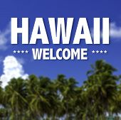 Hawaii, Welcome written on a beautiful beach background