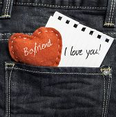 Boyfriend I love you! written on a peace of paper and a heart on a jeans background