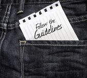 Follow the Guidelines written on a peace of paper on a jeans background