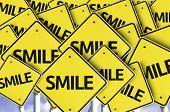 Smile written on multiple road sign