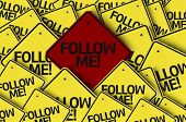 Follow Me! written on multiple road sign