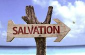 Salvation wooden sign with a beach on background