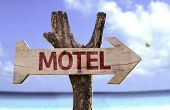 picture of motel  - Motel wooden sign with a beach on background  - JPG