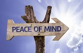 stock photo of peace-sign  - Peace of Mind wooden sign on a beautiful day - JPG