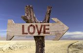 Love wooden sign with a desert background