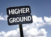 stock photo of snob  - Higher Ground sign with clouds and sky background  - JPG