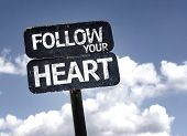 Follow your Heart sign with clouds and sky background
