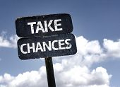 Take Chances sign with clouds and sky background