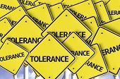stock photo of racial discrimination  - Tolerance written on multiple road sign  - JPG