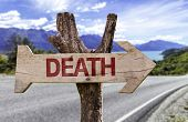 Death wooden sign with a street background