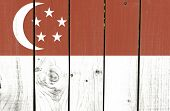 Singapore flag on wooden background
