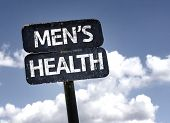 Men's Health sign with clouds and sky background