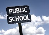 Public School sign with clouds and sky background