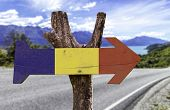 Romania wooden sign with a landscape background