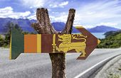 picture of sinhala  - Sri Lanka wooden sign with a landscape background - JPG
