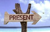 Present wooden sign with a beach on background