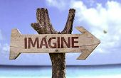 Imagine wooden sign with a beach on background