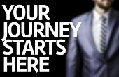 Your Journey Starts Here written on a board with a business man on background