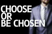Choose or Be Chosen written on a board with a business man on background