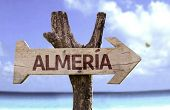 Almeria wooden sign with a beach on background