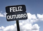 Happy October (In Portuguese) sign with clouds and sky background