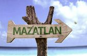 Mazatlan wooden sign with a beach on background