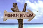 picture of naturist  - French Riviera wooden sign with a beach on background - JPG
