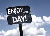 Enjoy Your Day sign with clouds and sky background