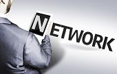 Business man with the text Network in a concept image