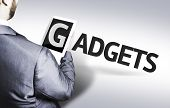 Business man with the text Gadgets in a concept image