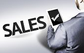 Business man with the text Sales in a concept image