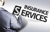 Business man with the text Insurance Services in a concept image