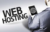 Business man with the text Web Hosting in a concept image