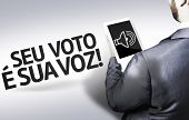Business man with the text Your Vote is Your Voice (In Portuguese) in a concept image