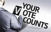 Business man with the text Your Vote Counts in a concept image