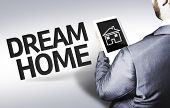 Business man with the text Dream Home in a concept image