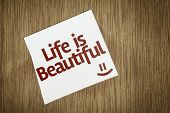 Life is Beautiful on Paper Note on texture background